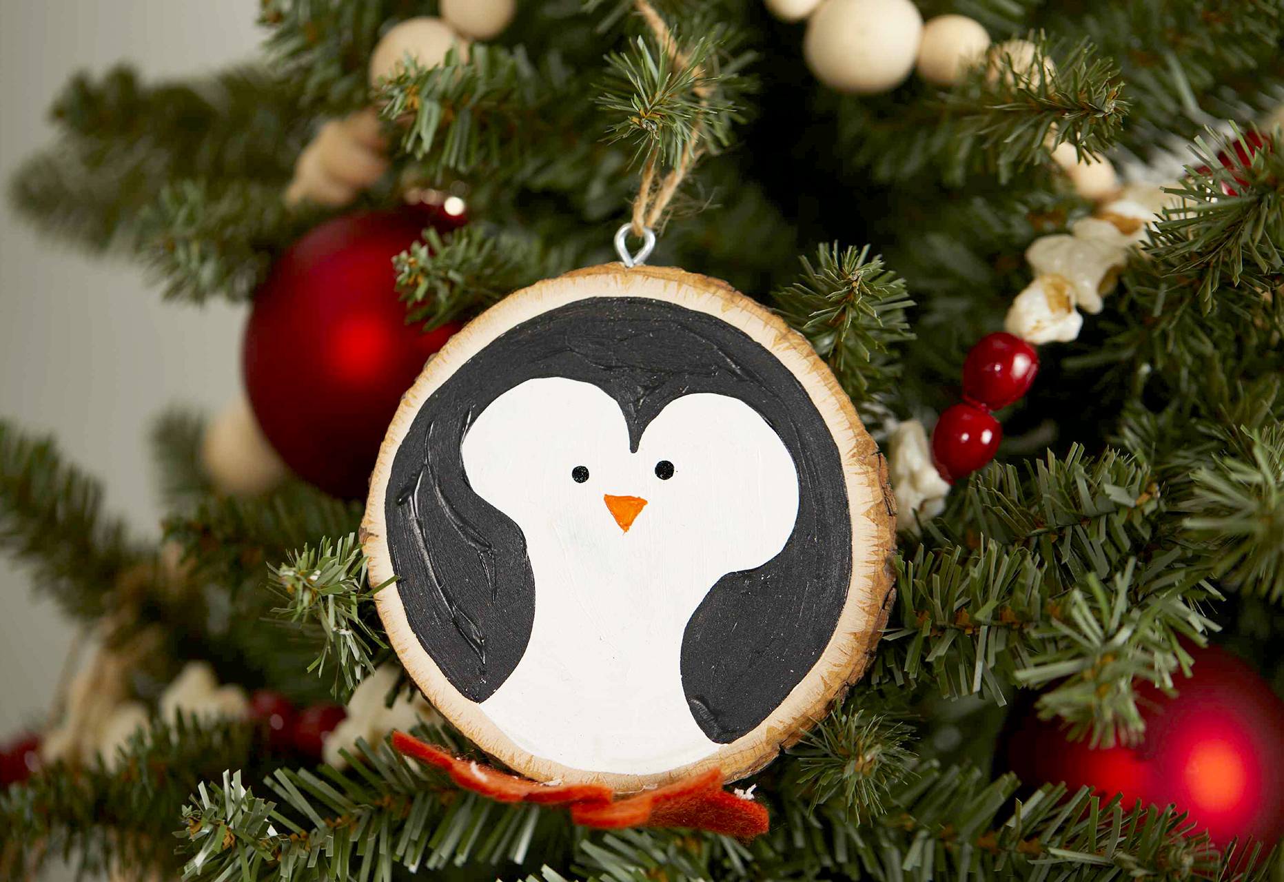 penguin wood slice ornament with paint and felt