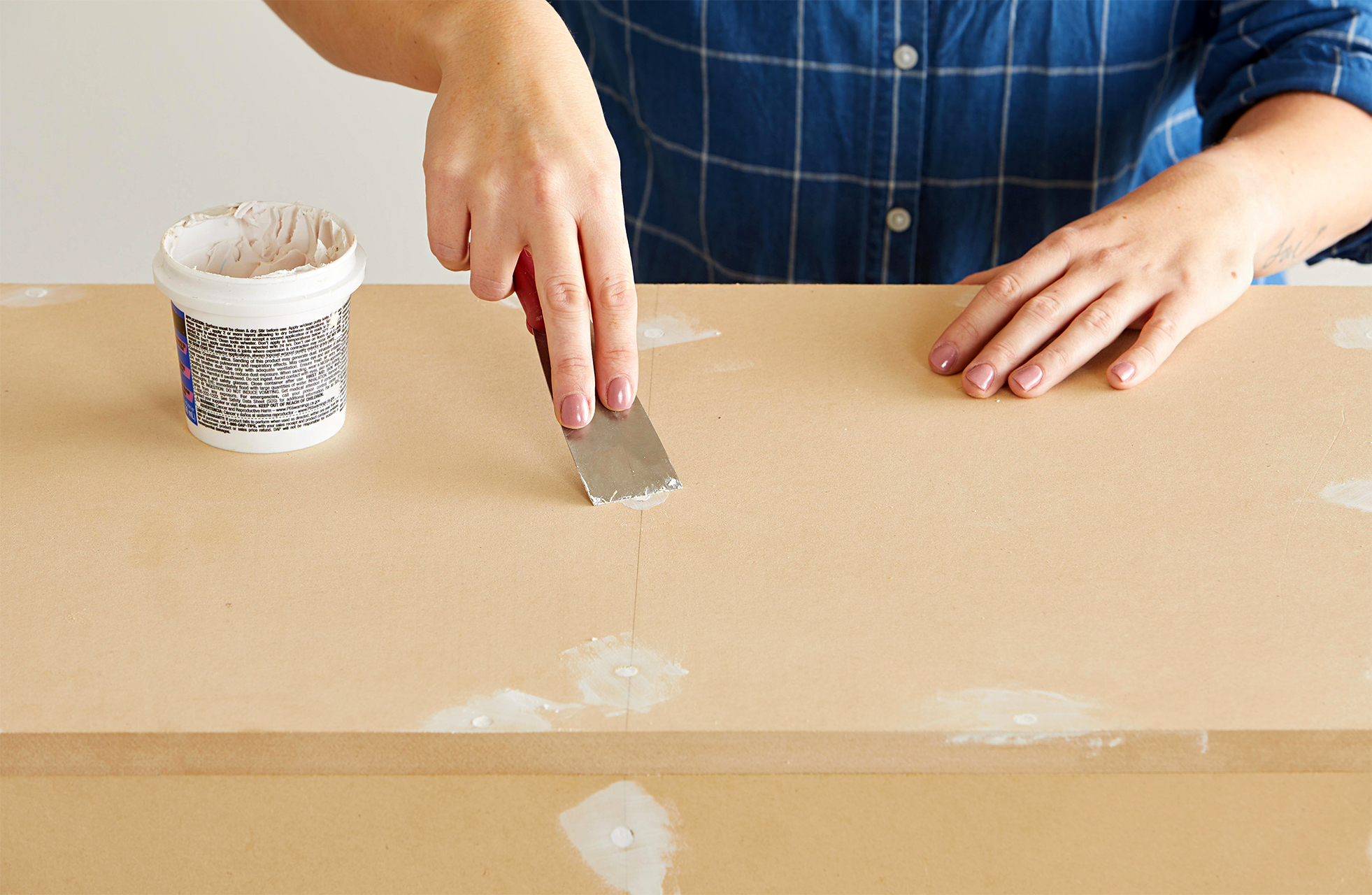 use putty and knife to fill screw holes