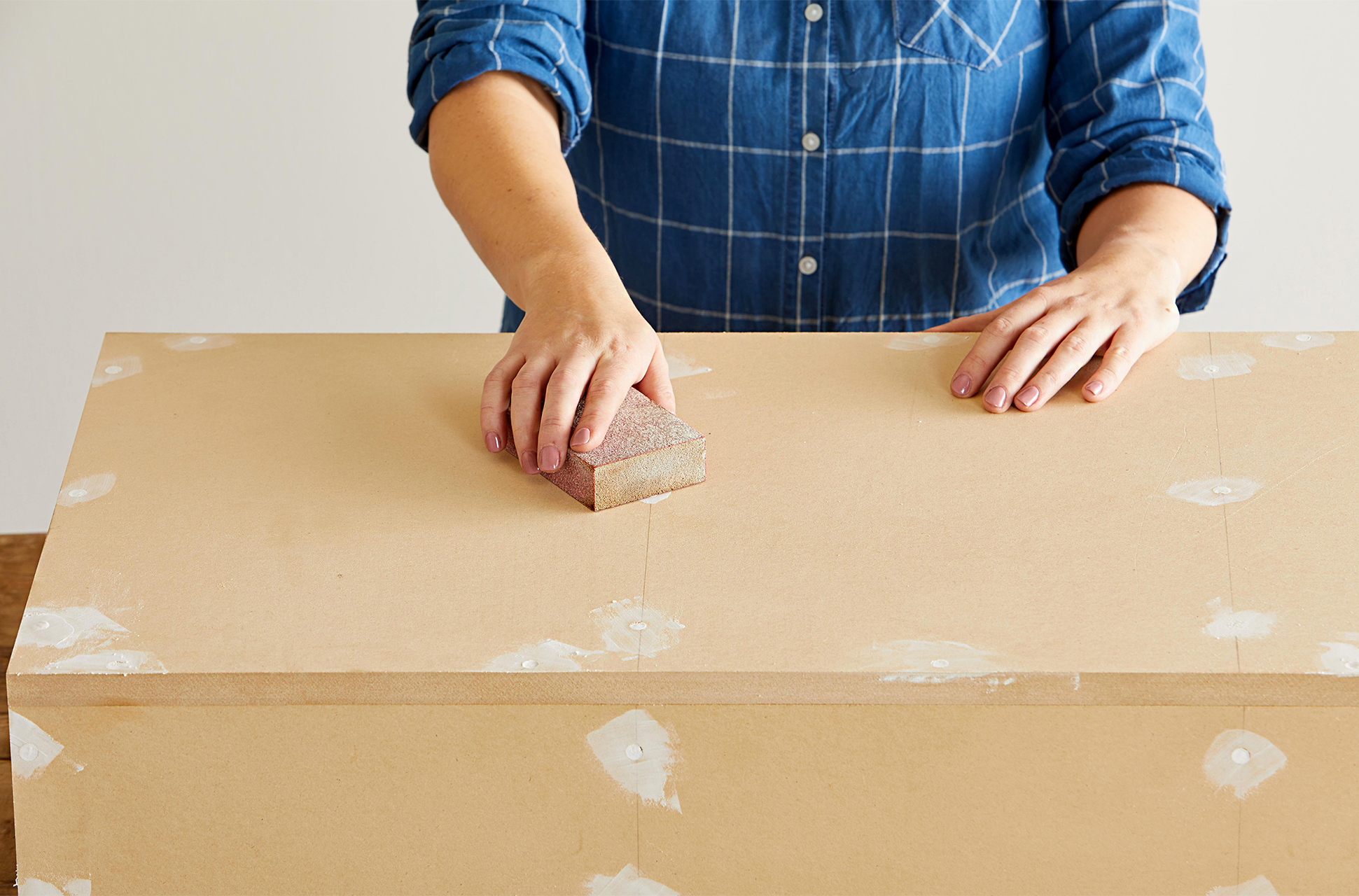 use sanding block to smooth rough surfaces