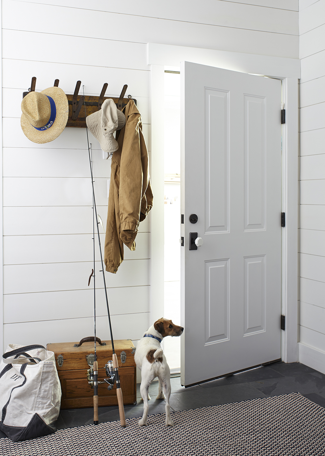 mudroom with coat hangers in modern farmhouse