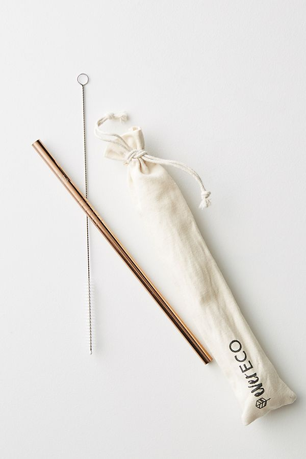 Gold straw with a white drawstring bag
