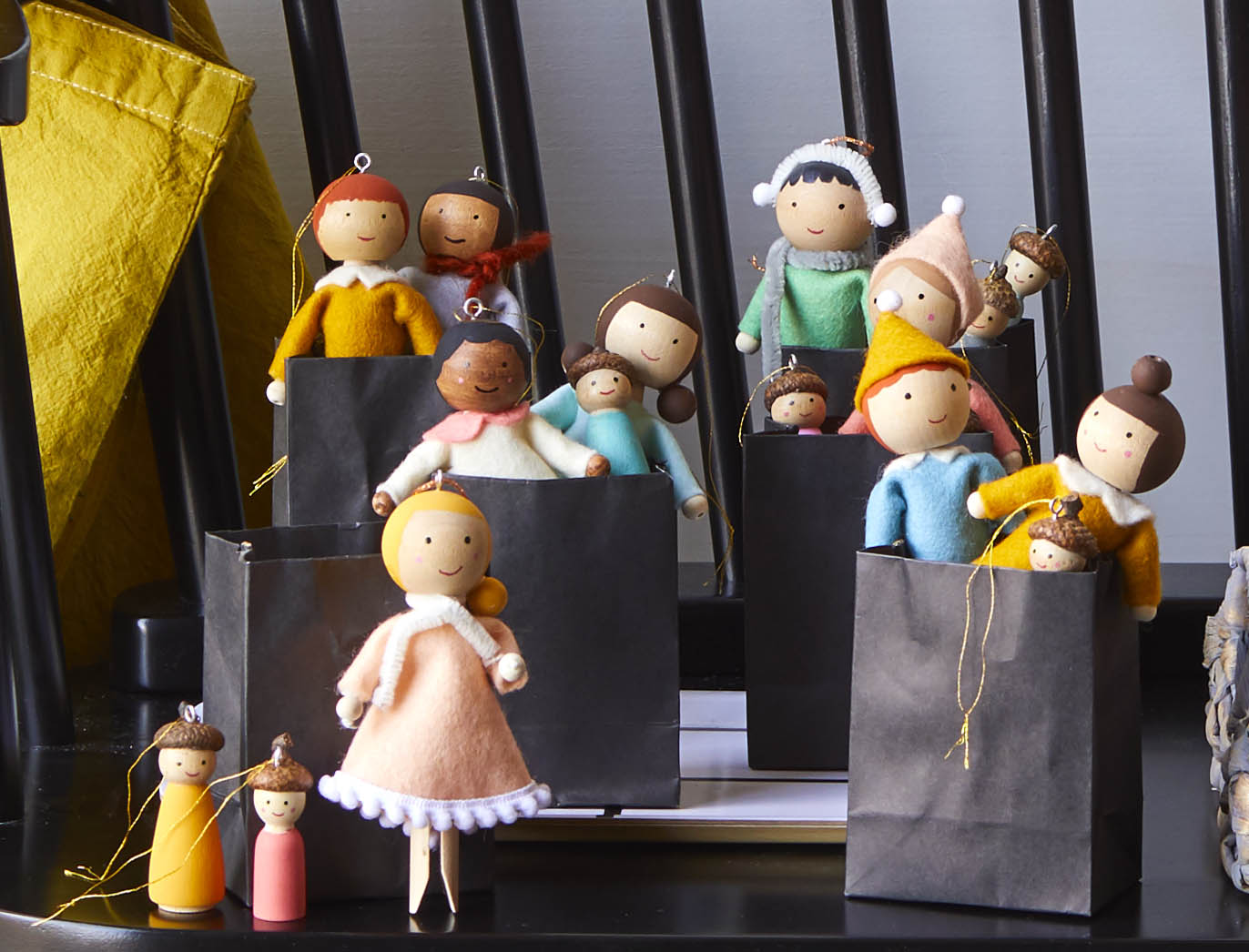 Wood dolls with brightly colored fabric clothing