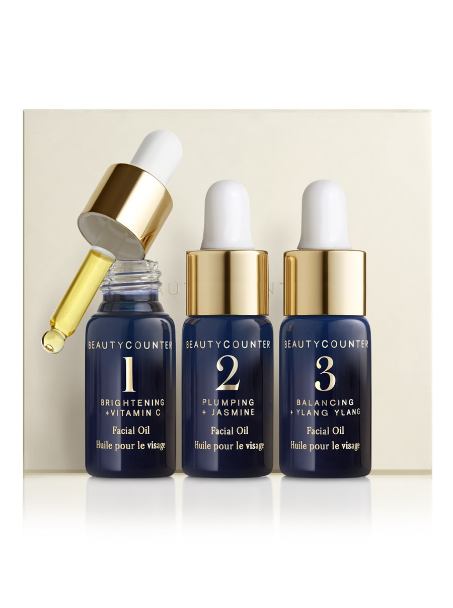 three dropper bottles navy with gold tops