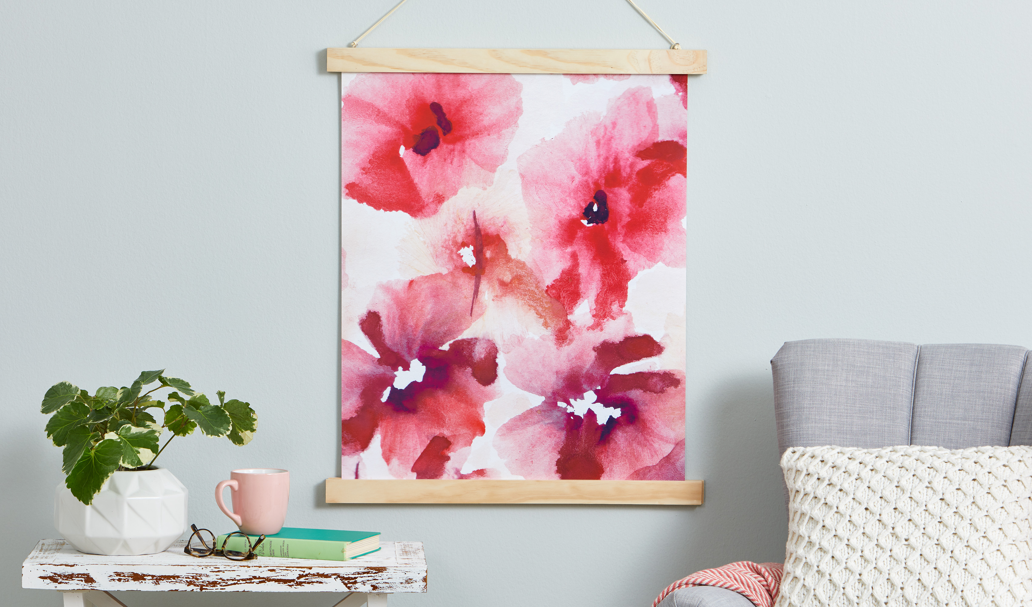 poster holder holding pink floral poster close-up