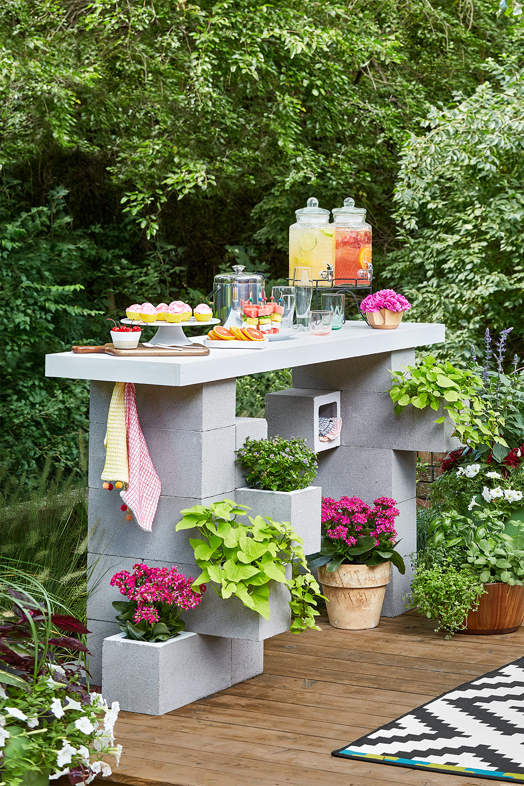 completed concrete block bar with buffet of fruit lemonade and desserts