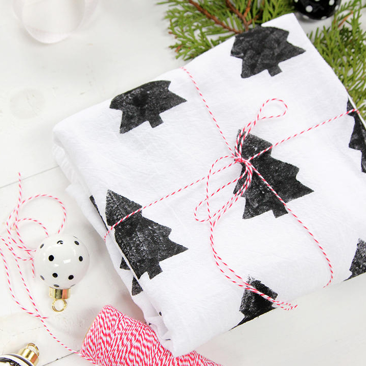 white towel with black christmas trees tied with red and white string