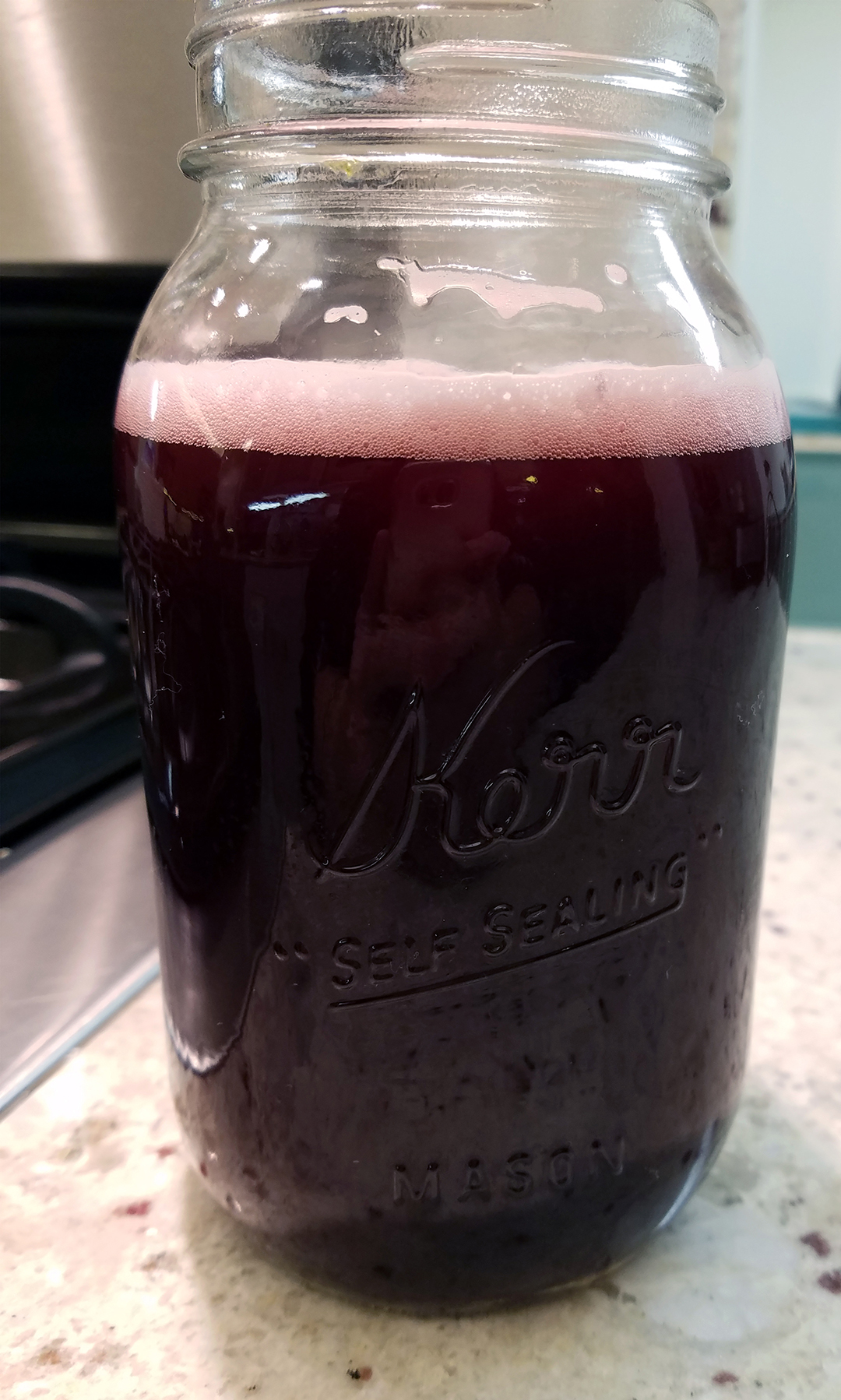 Instant Pot wine in a mason jar with bubbles or fizz on top