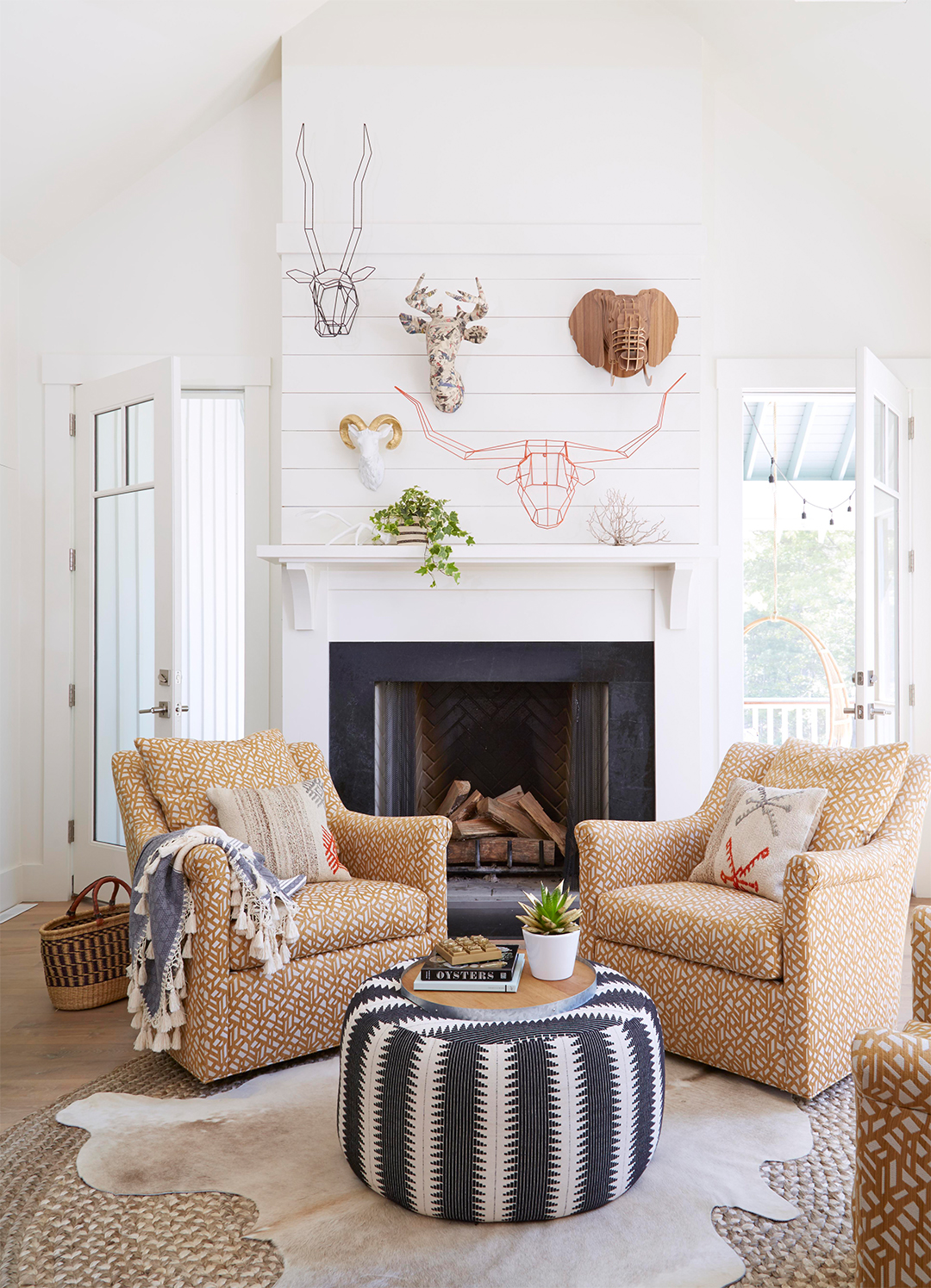 sculptural mounted heads fireplace living room
