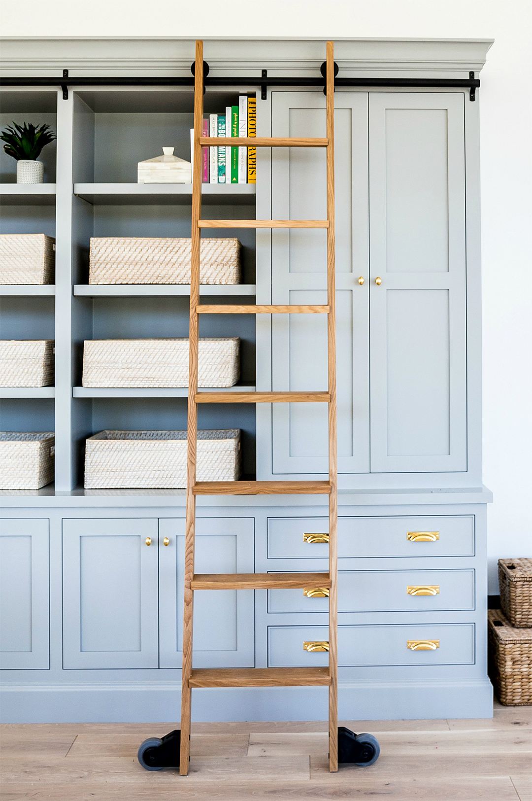blue gray bookcase storage with sliding ladder