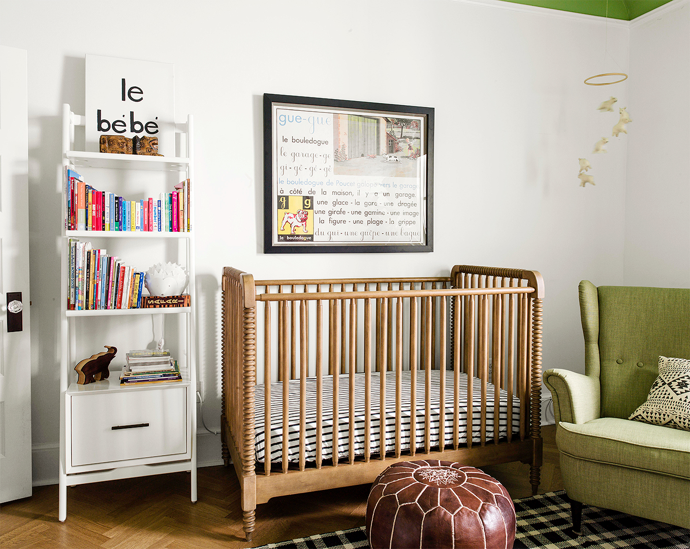 neutral woodsy nursery with muted greens