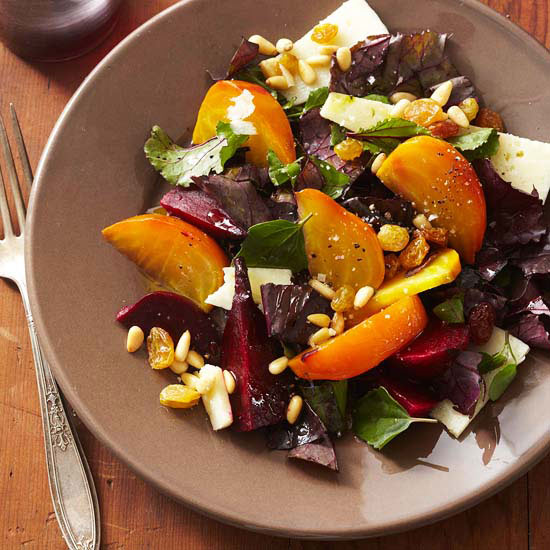 Roasted Beet Salad with Shredded Greens, Golden Raisins, and Pine Nuts
