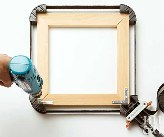 secure clamps at seams of picture frame