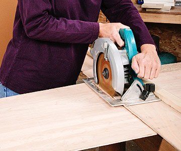 making a cut using a circular saw guided by a straightedge jig