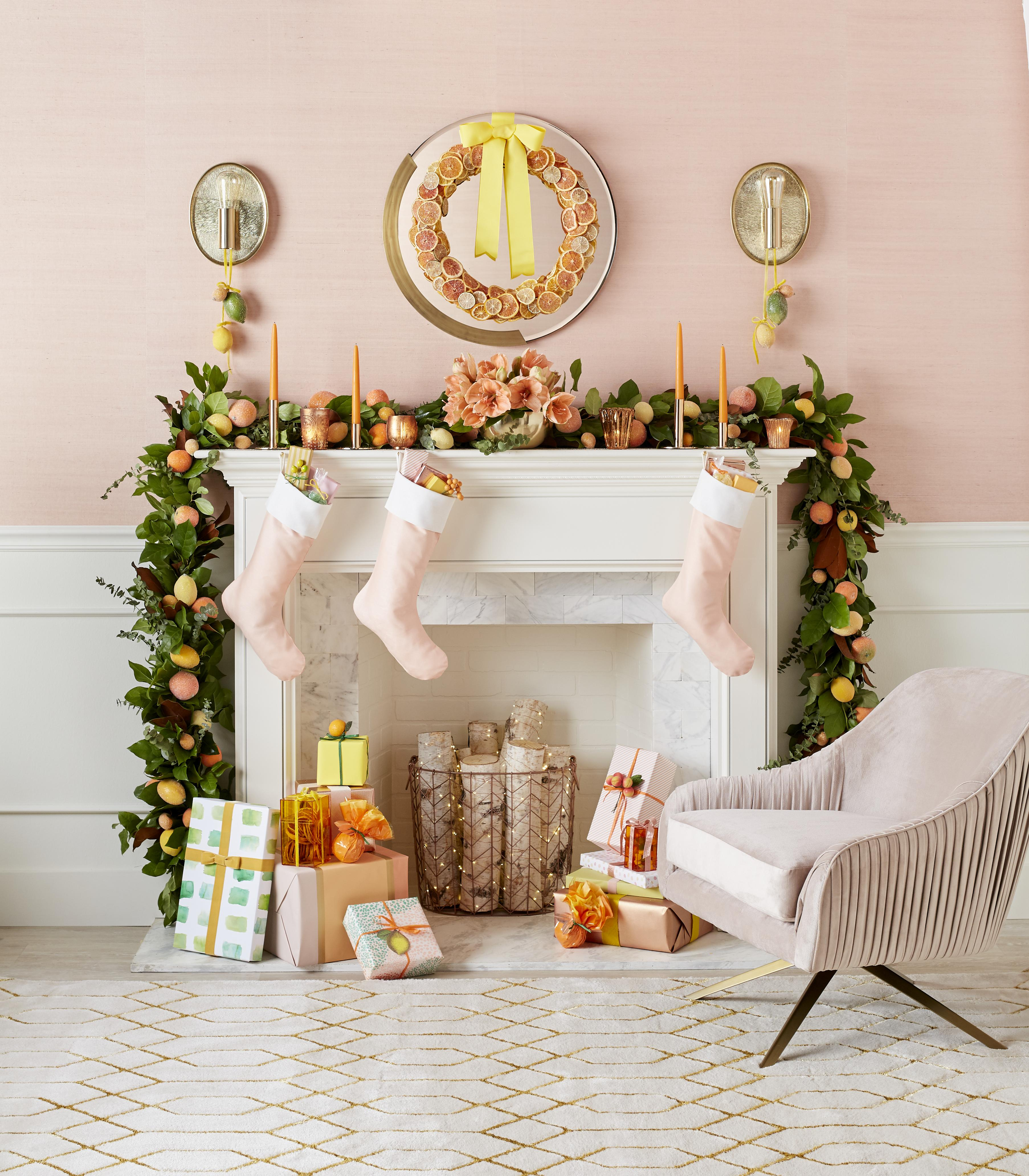Pink and orange Christmas decorations with garland and Citrus wreath