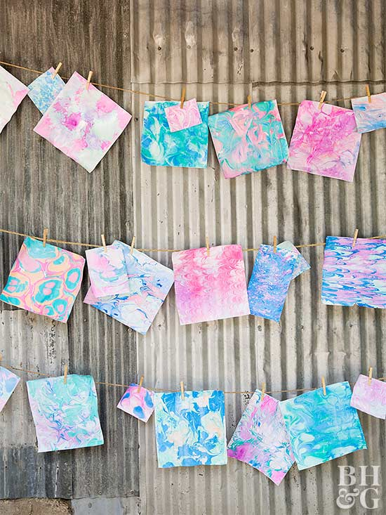 paper marbling party prints hung up to dry