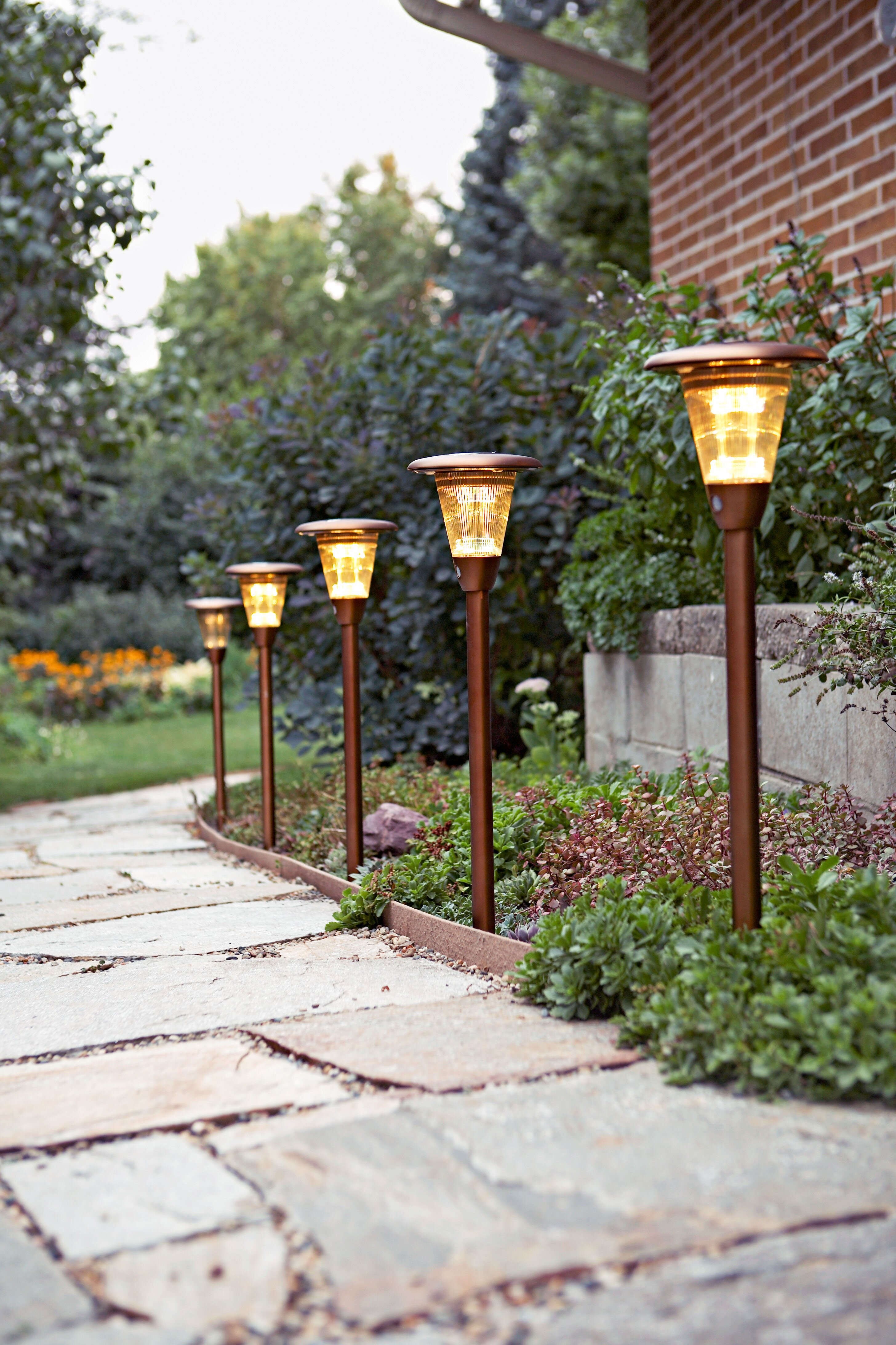 lighted solar lights along stone walking path