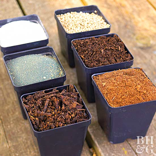 variety of soil amendments in blue containers
