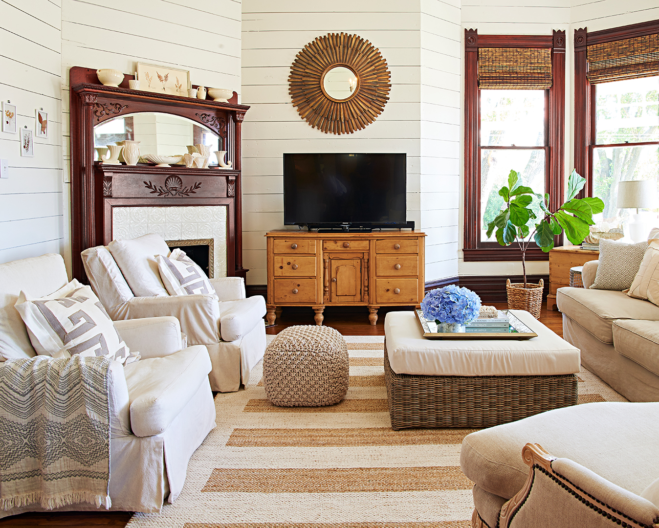 living room seating with fireplace and wicker ottoman