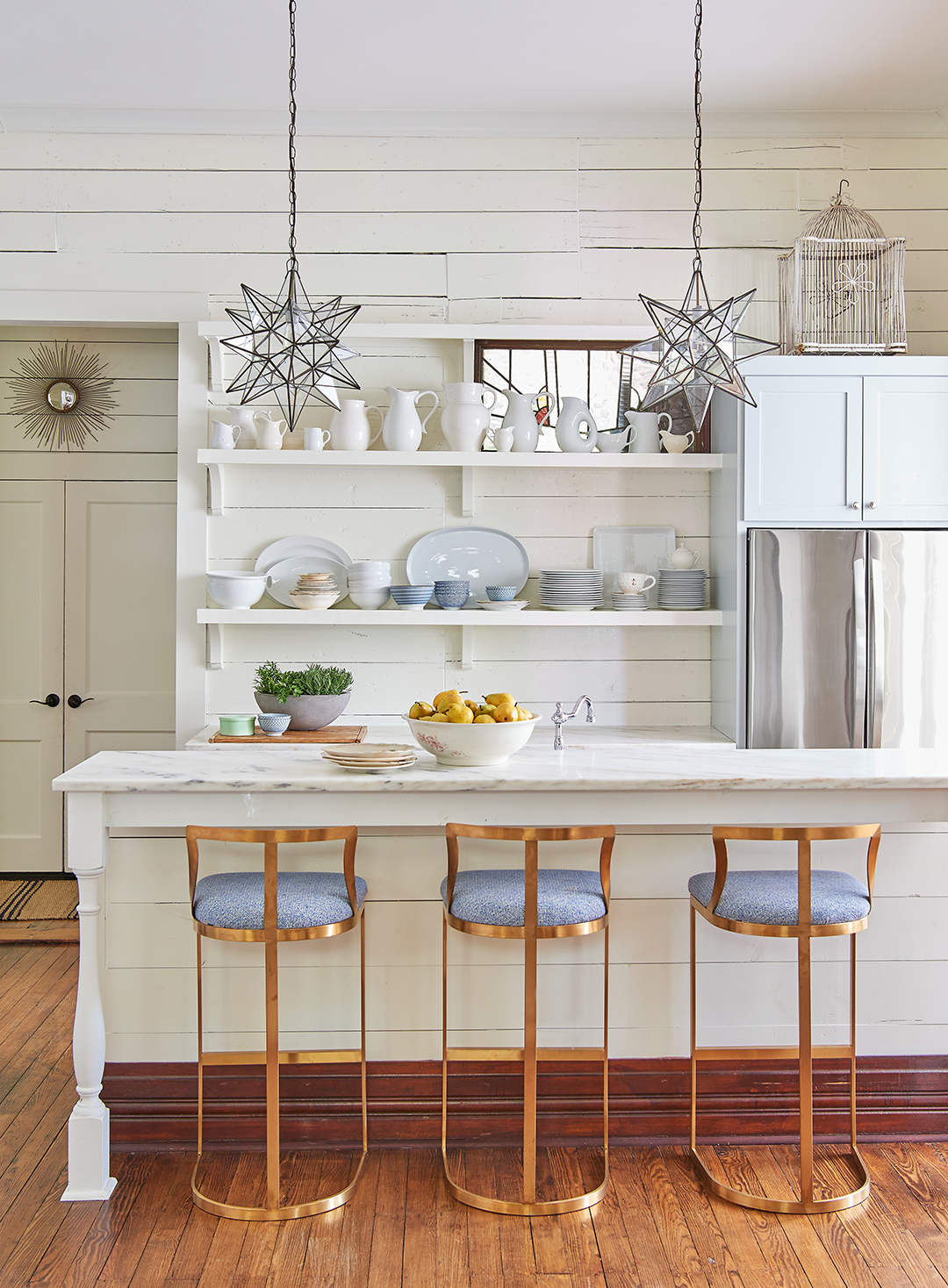 kitchen island with stools and hanging lights