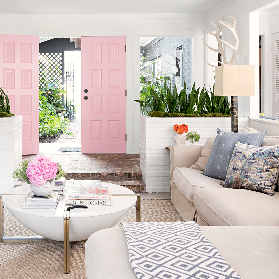 pink doors and flowers in living room with couch