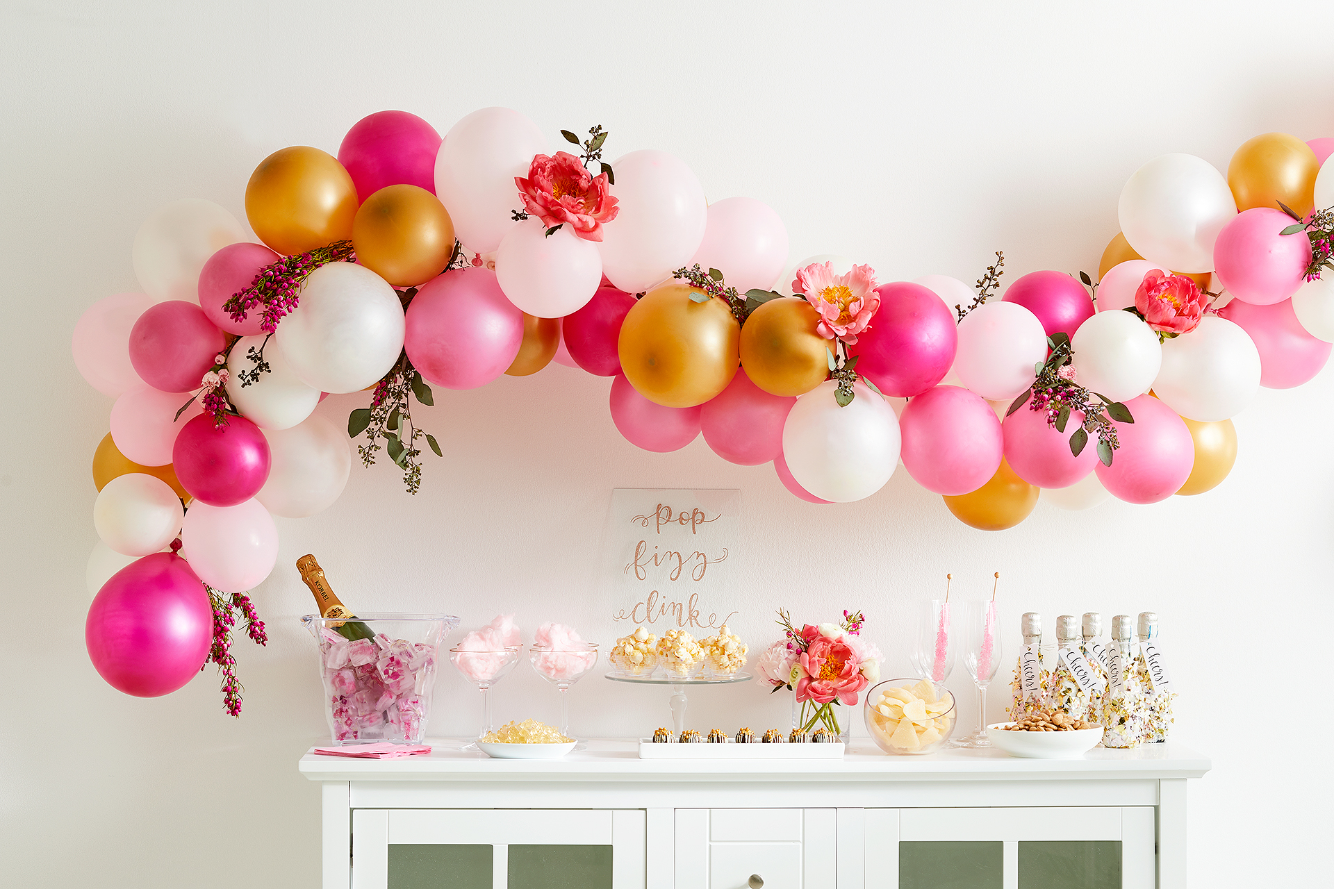 gold and pink decor and balloon banner