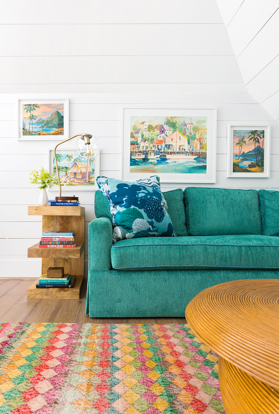 green couch with framed hawaiian paint by numbers