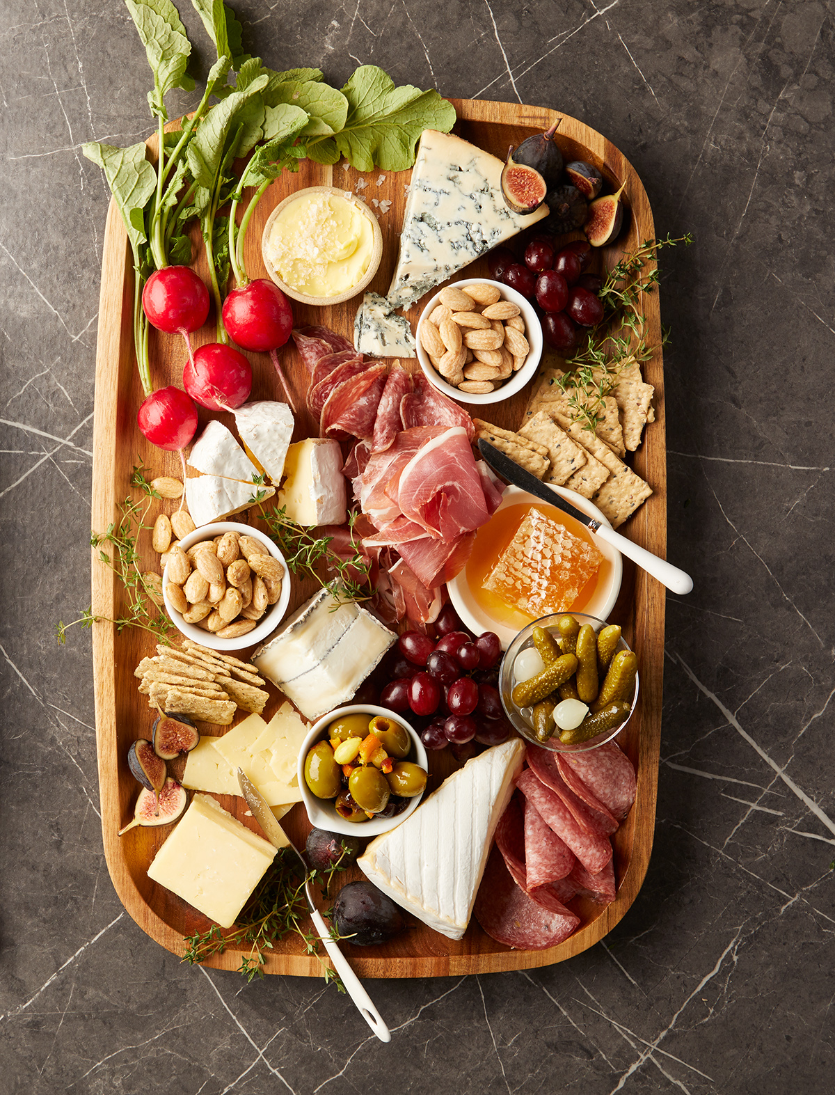 full charcuterie board with almonds fruit and veggies