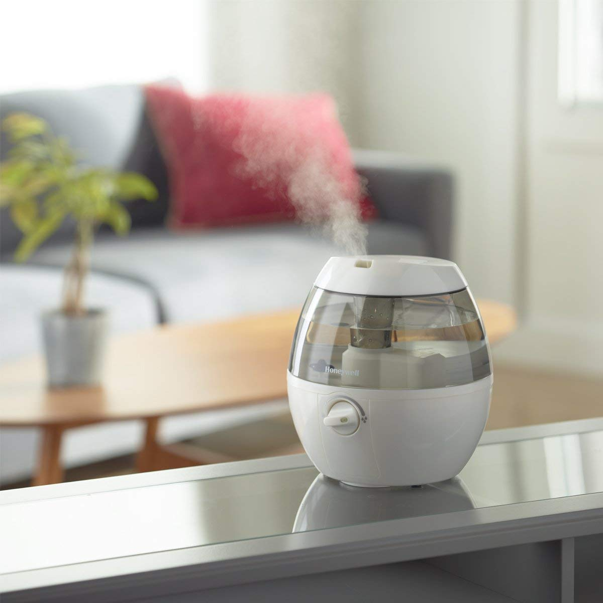 white humidifier sitting on counter.