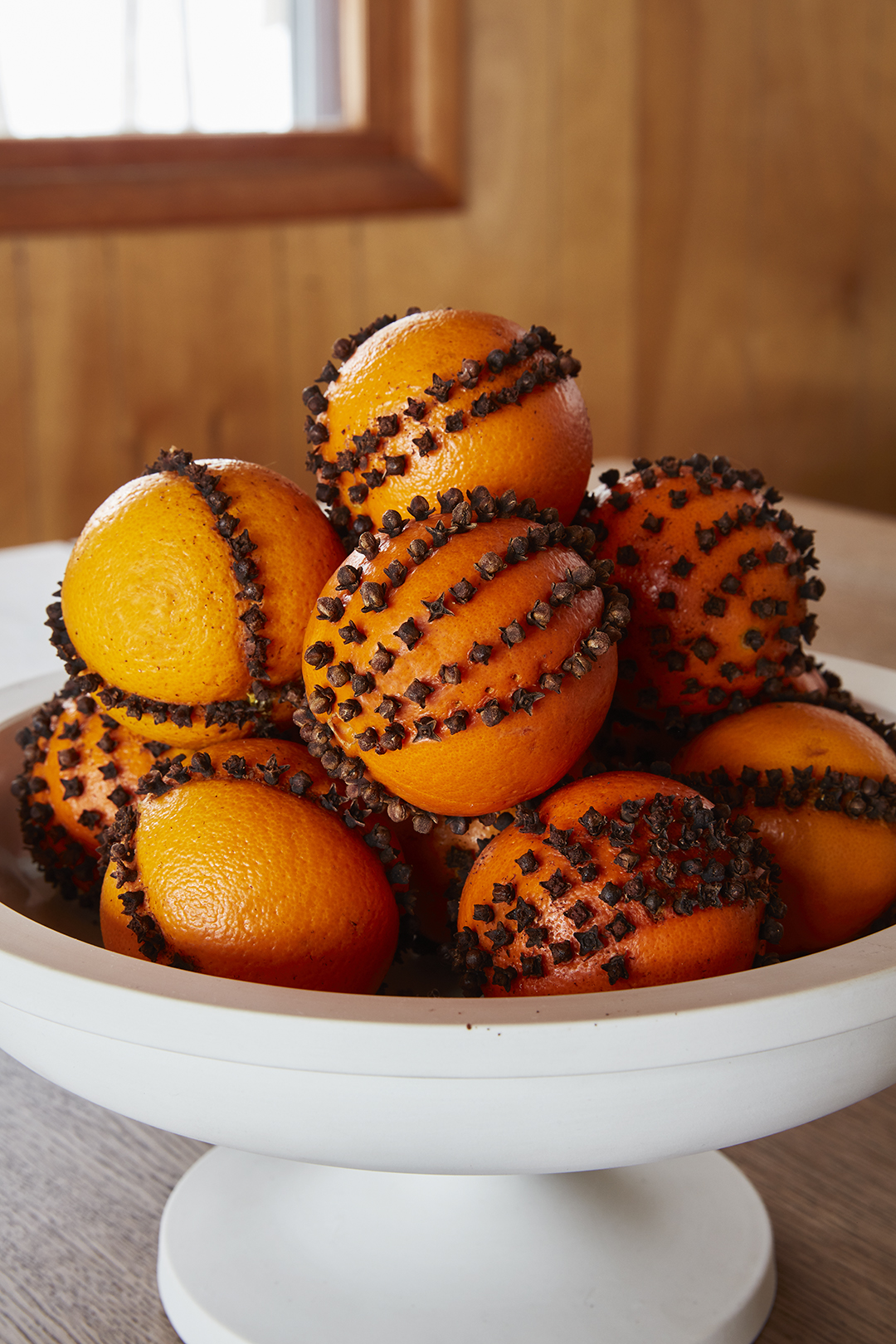 pomander bowl of oranges with cloves