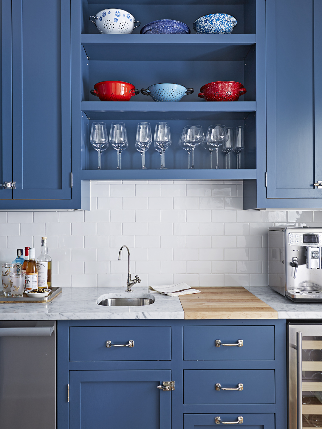 kitchen with subway tile and blue cabinets