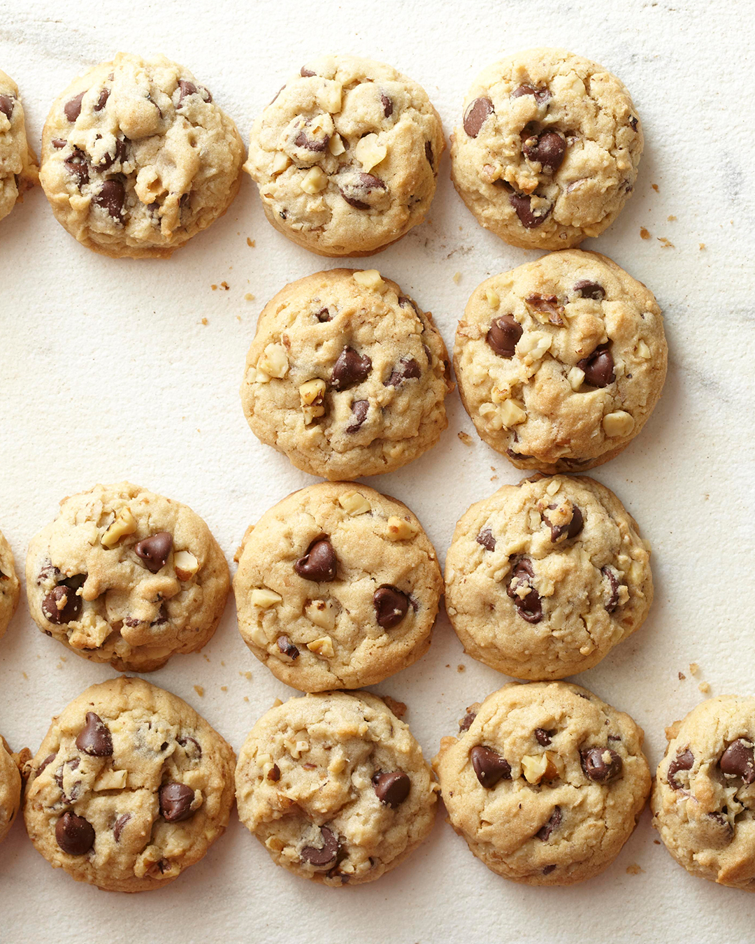 Our Best Basic Chocolate Chip Cookies lined up on counter top