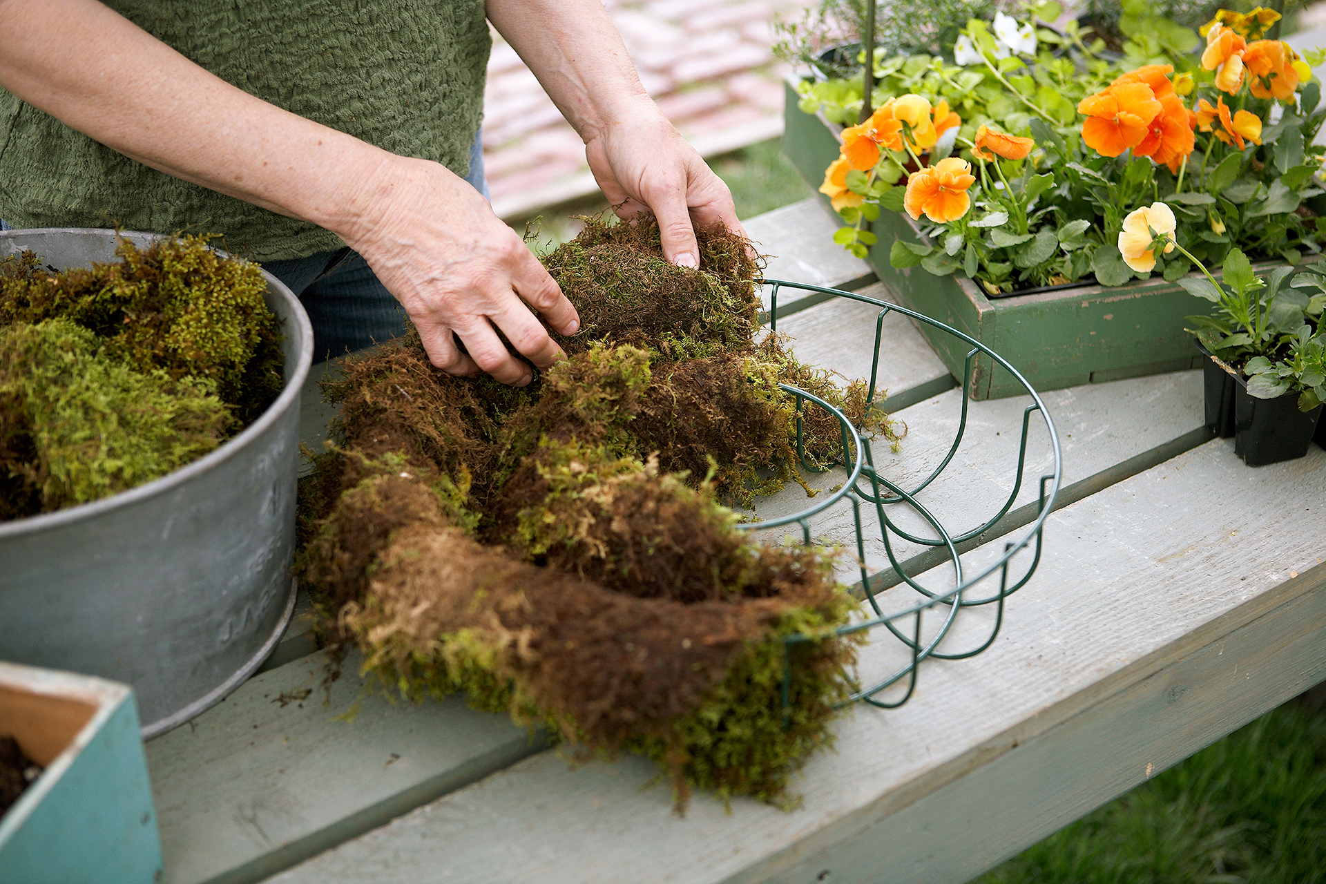 place layer of sheet moss into wreath form