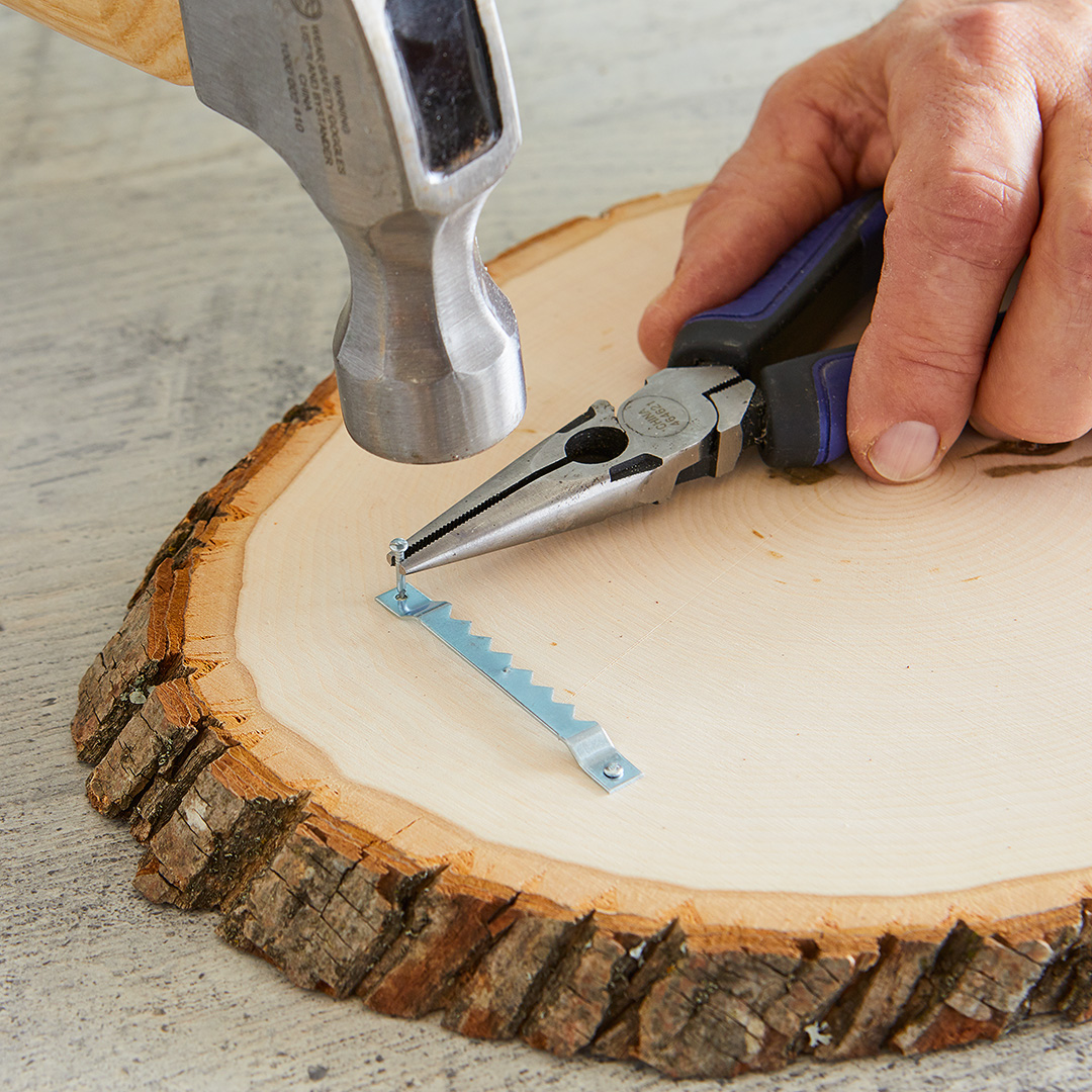 attaching picture hanger to wood slice