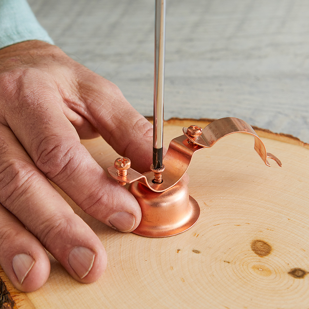 securing pipe hanger to wood slice