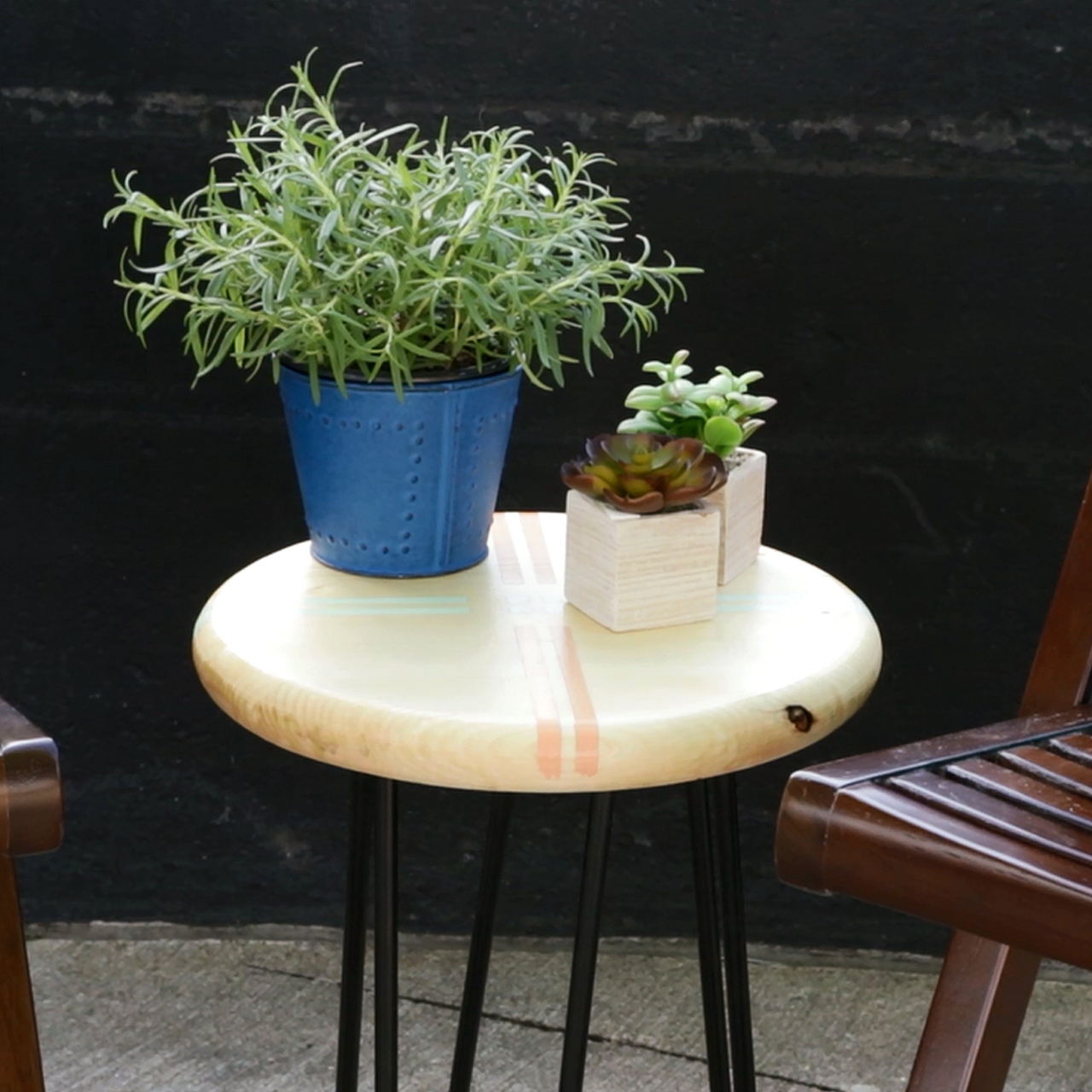 hairpin leg table with green container plants blue