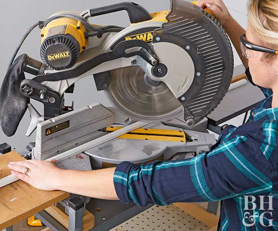 woman using table saw to cut molding pieces