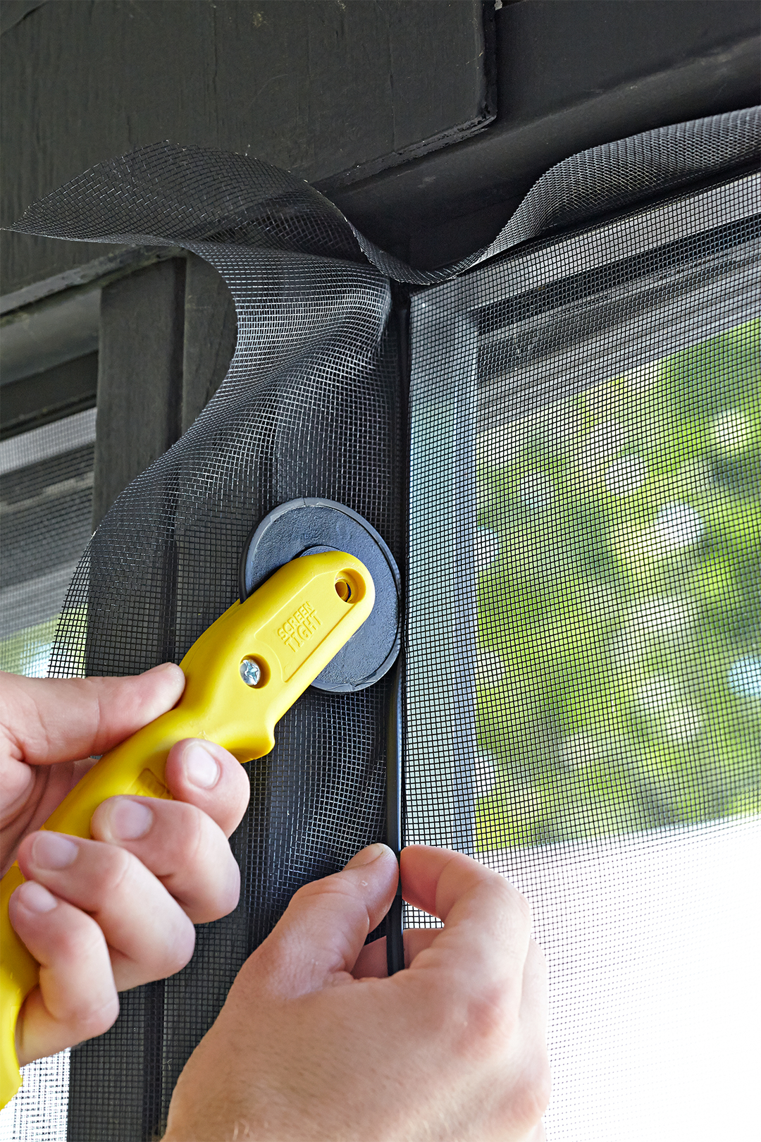install screen system trim excess screen with roller knife