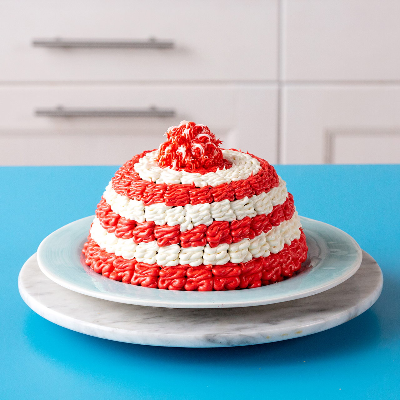 red and white winter hat cake on plate