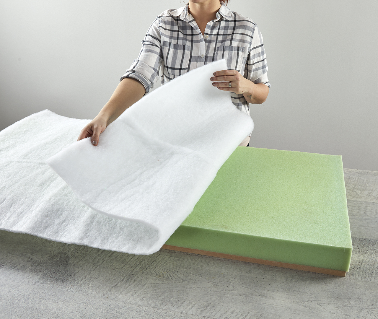 covering foam backing of tufted bench