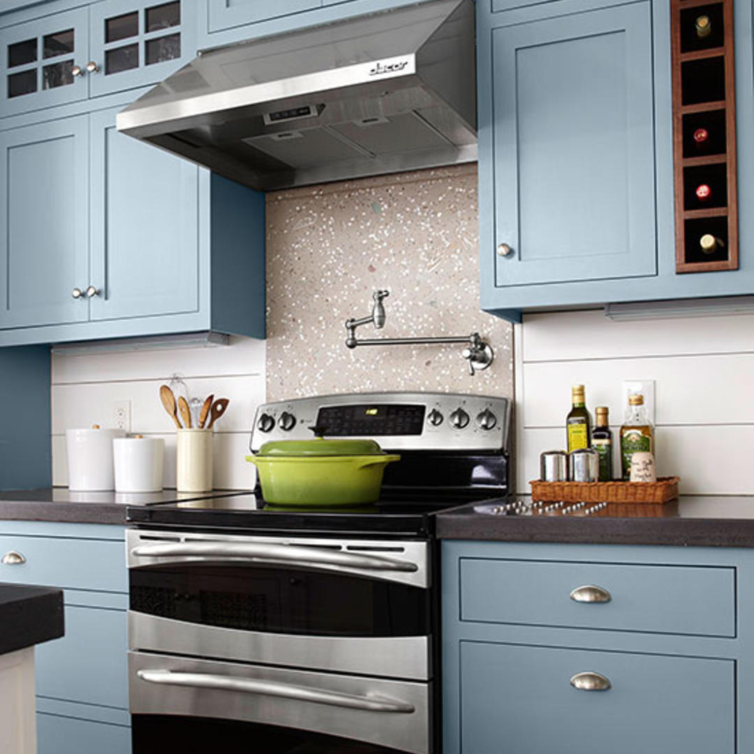 Blue cabinets with silver hardware