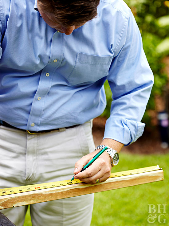Man measuring and marking wood
