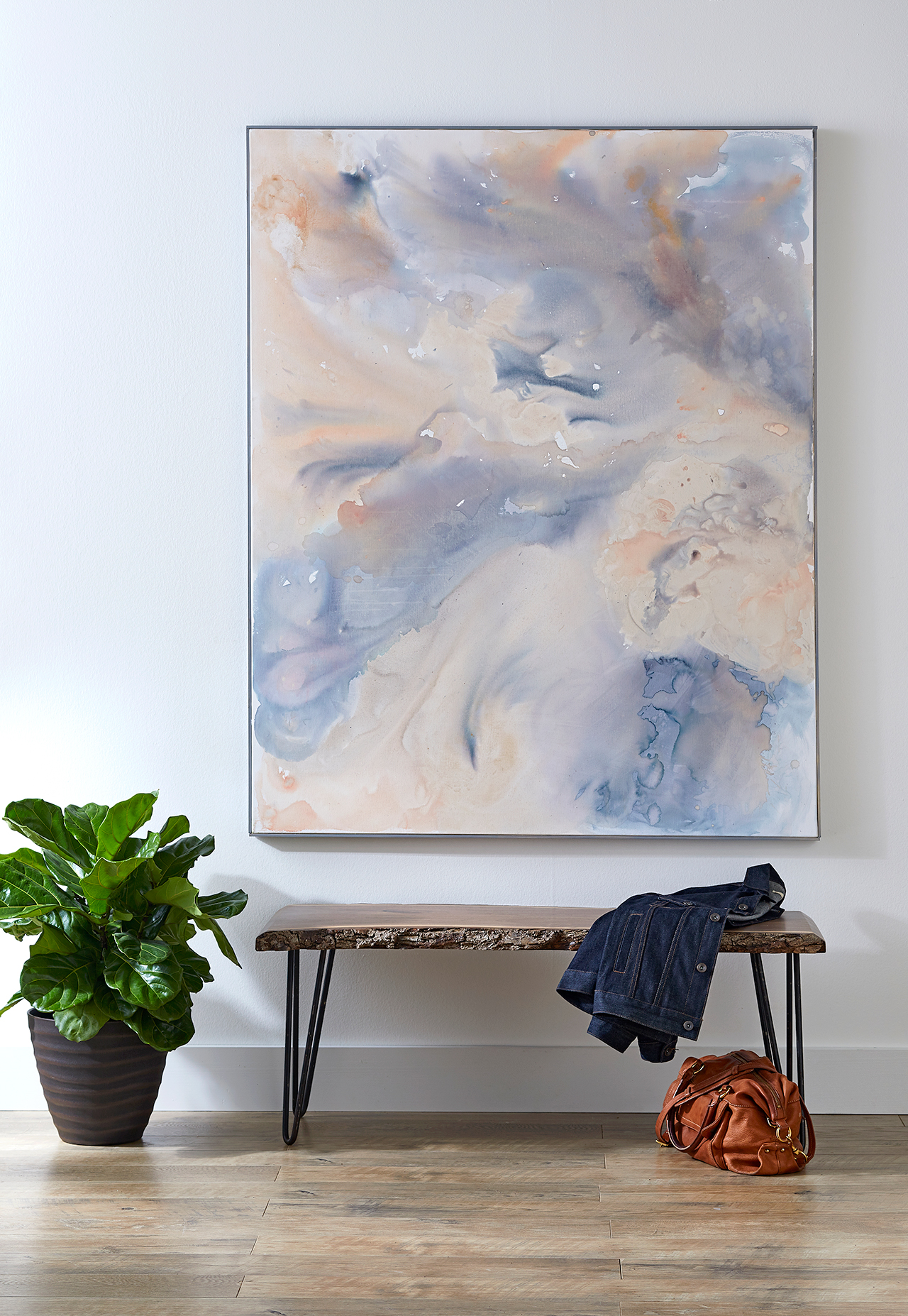 large framed watercolor swirl artwork and bench