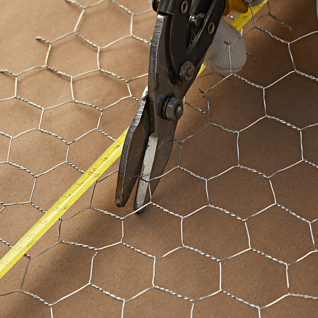 using tin snips to cut chicken wire