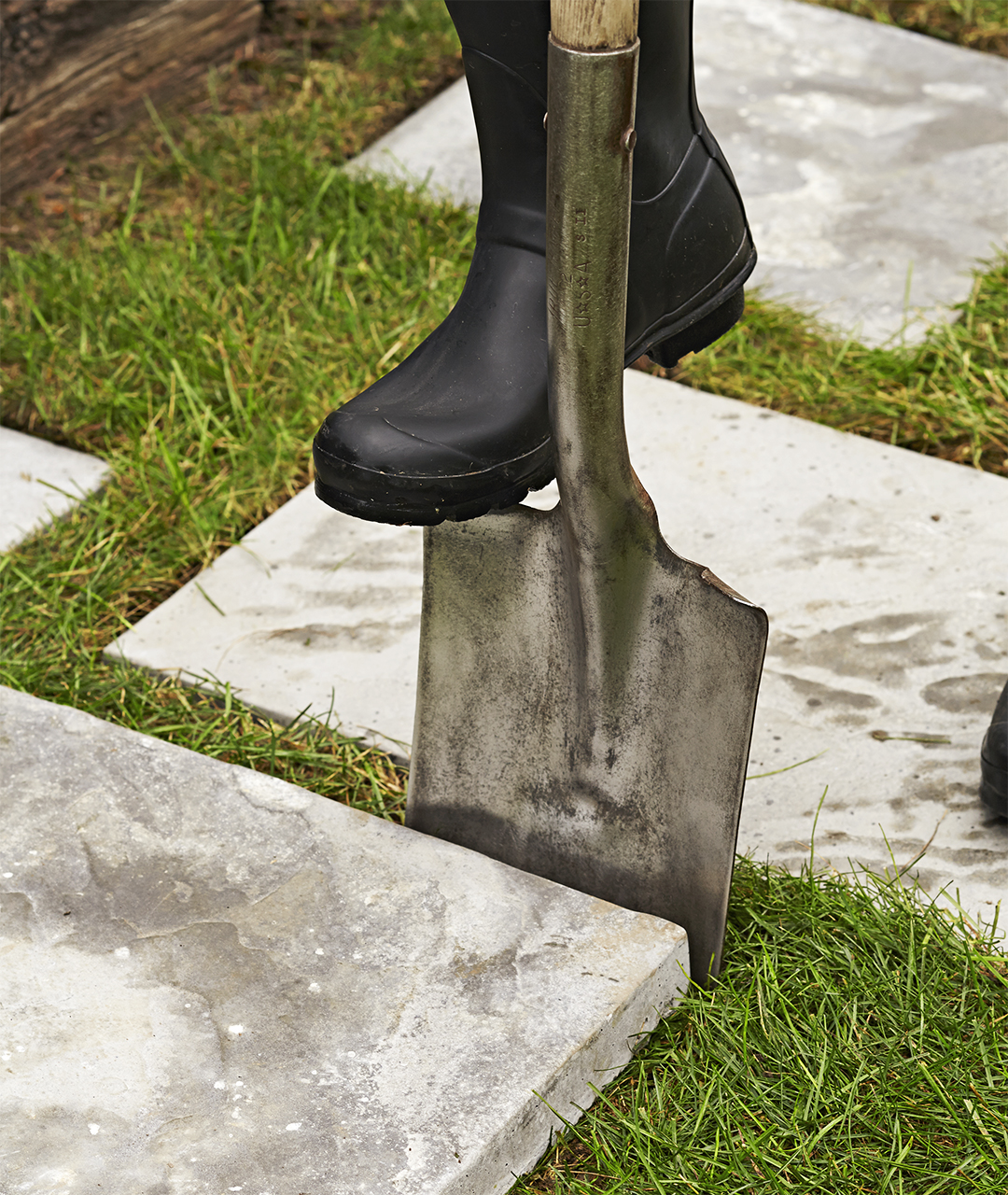 use a spade to align paving stones