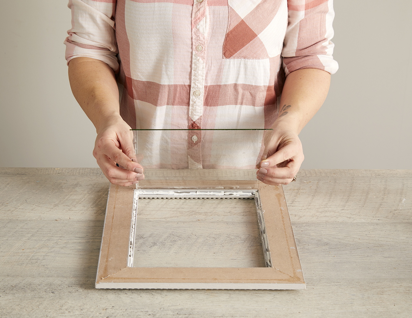 gluing glass from picture frame to frame