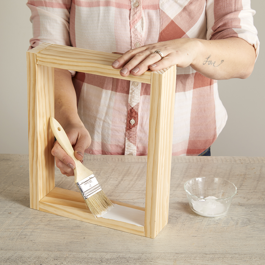 adding glue for fabric on shadow box