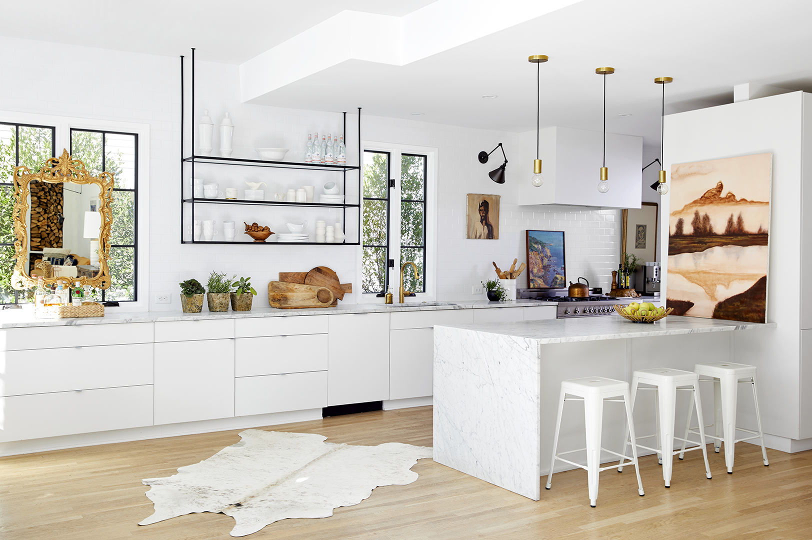 steel and glass shelves in open modern kitchen