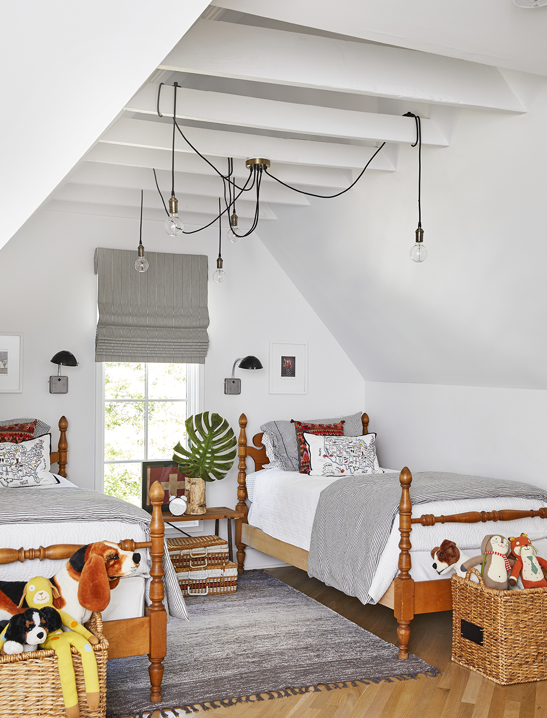 corded lights on rafters in boys bedroom