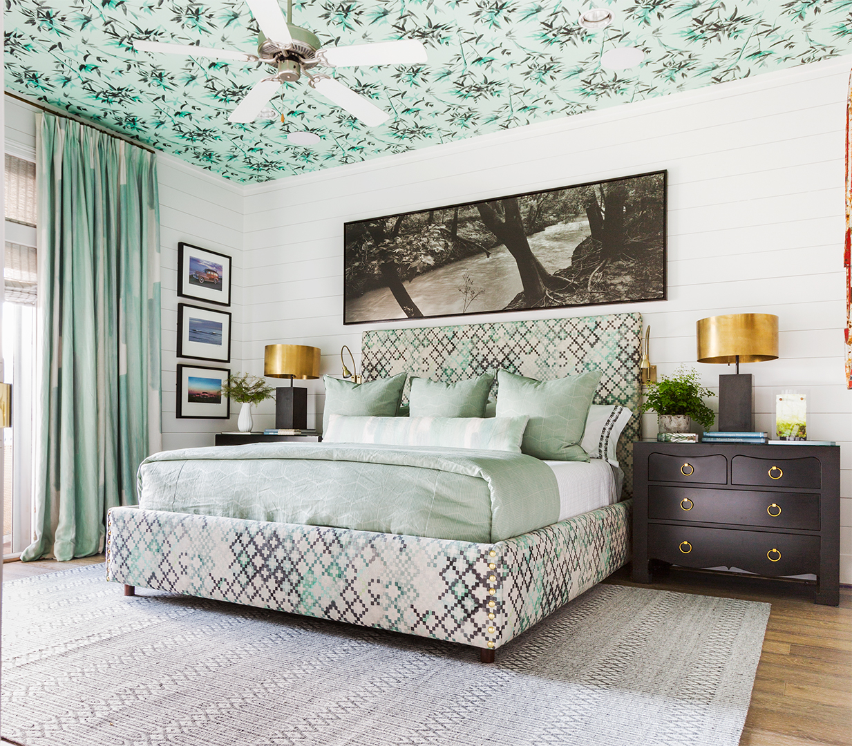 seafoam green bedroom with palm patterned ceiling