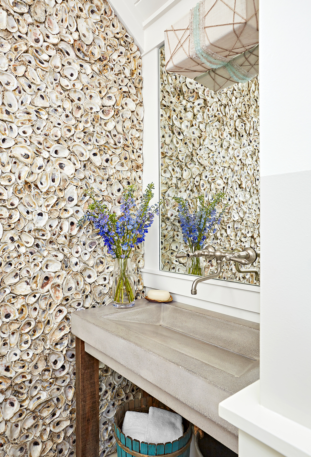 oyster shell wall plus concrete sink in powder room